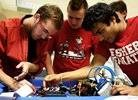 Fishers high school students looking at robotics boards