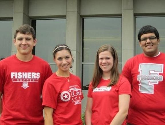 Four FHS students wearing Fishers t-shirts